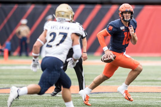 Illinois quarterback Brandon Peters (18), who transferred from Michigan, rolls out in the first half Saturday.