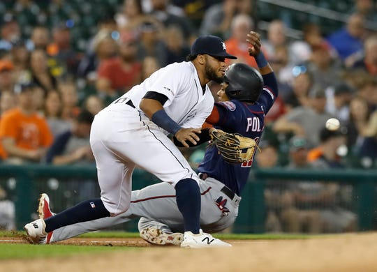 Minnesota Twins' Jorge Polanco beats the throw to Detroit Tigers third baseman Dawel Lugo during the fourth inning.