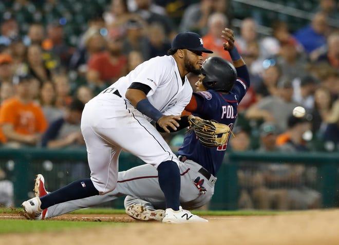 Minnesota Twins' Jorge Polanco beats the throw to Detroit Tigers third baseman Dawel Lugo during the fourth inning.