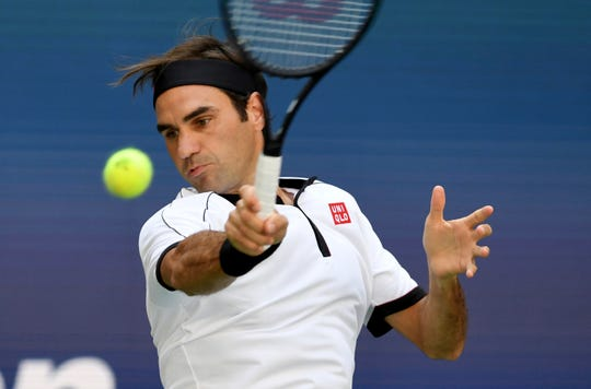 Roger Federer returns a shot to Daniel Evans during the third round of the U.S. Open on Friday.