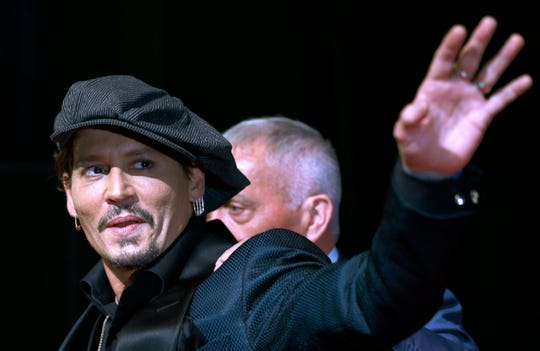 FILE - In this Tuesday, June 20, 2017, file photo, U.S. actor Johnny Depp waves for fans upon his arrival at a film premier in Tokyo. A new ad for a Dior men's fragrance called Sauvage, in which Depp appears, sparked outrage Friday, Aug. 30, 2019, for its use of Native American culture and symbols.