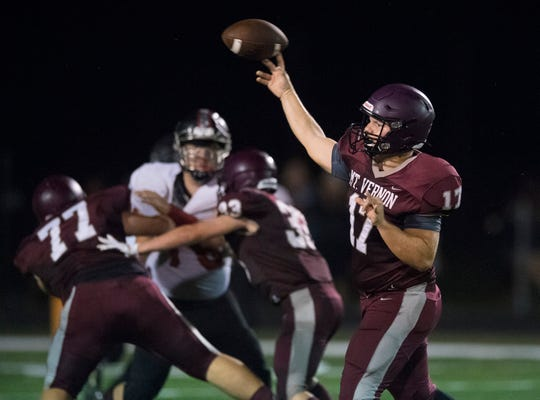 Mt. Vernon's Rhett Snodgrass (17) passes the ball during the North Posey Vikings vs Mt. Vernon Wildcats Posey County rivalry game at Memorial Field Friday evening, Aug. 30, 2019.