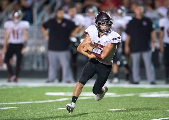 North Posey's Zach Lowe (9) carries the ball during the North Posey Vikings vs Mt. Vernon Wildcats Posey County rivalry game at Memorial Field Friday evening, Aug. 30, 2019.
