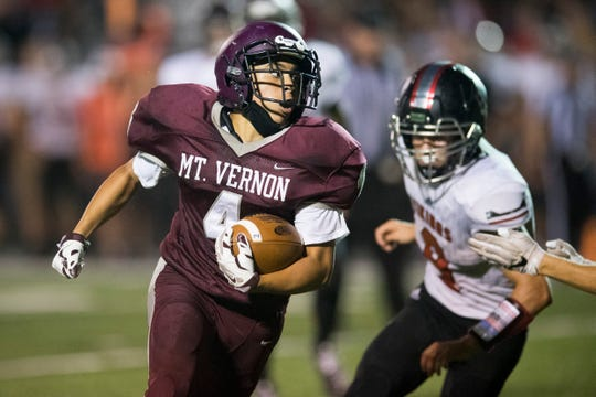 Mt. Vernon's Dylan Murray (4) carries the ball during the North Posey Vikings vs Mt. Vernon Wildcats Posey County rivalry game at Memorial Field Friday evening, Aug. 30, 2019.