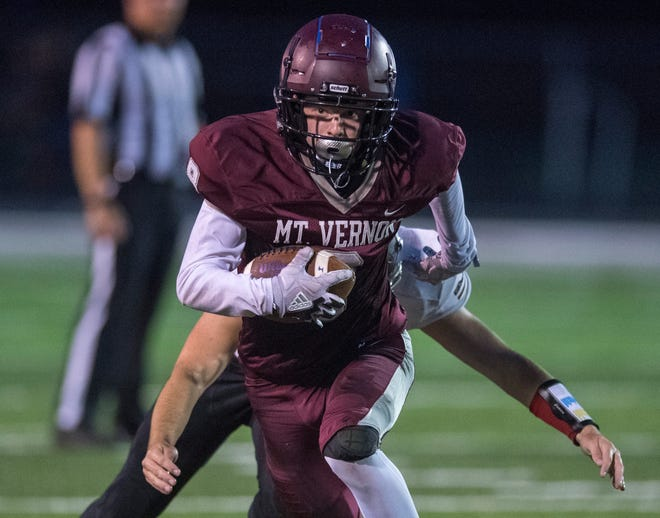 Mt. Vernon's Breckan Austin (8) carries the ball during the North Posey Vikings vs Mt. Vernon Wildcats Posey County rivalry game at Memorial Field Friday evening, Aug. 30, 2019.