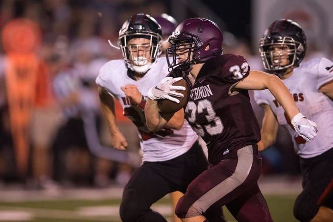 Mt. Vernon's Brady Hook (33) carries the ball during the North Posey Vikings vs Mt. Vernon Wildcats Posey County rivalry game at Memorial Field Friday evening, Aug. 30, 2019.