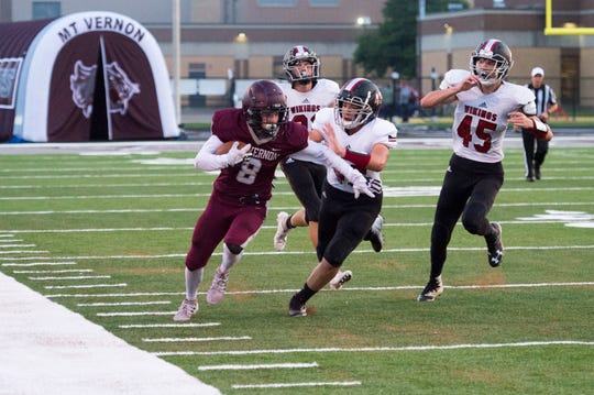 Mt. Vernon's Breckan Austin (8) runs the line with North Posey Vikings defense on his tail during the Posey County rivalry game at Memorial Field Friday evening, Aug. 30, 2019.