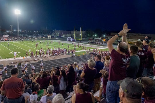 The Mount Vernon Wildcats crowd erupts after a touchdown during the rivalry game against North Posey on Aug. 30.