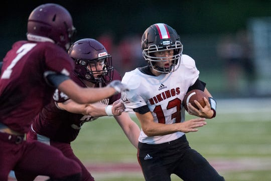 North Posey's Jaxon Wiggins (13) is tackled by Wildcat defense during the North Posey Vikings vs Mt. Vernon Wildcats Posey County rivalry game at Memorial Field Friday evening, Aug. 30, 2019.