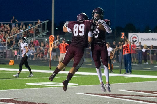 Mt. Vernon's Breckan Austin (8) and Mt. Vernon's Thayer Washabaugh (89) celebrate after a touchdown during the North Posey Vikings vs Mt. Vernon Wildcats Posey County rivalry game at Memorial Field Friday evening, Aug. 30, 2019.