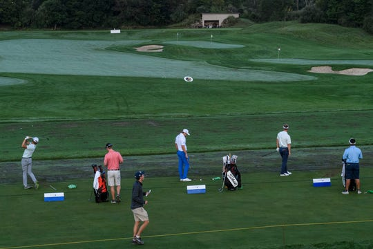Golfers prepare for the first round of the Korn Ferry Tour Championship at Victoria National Golf Club in Newburgh, Ind., Friday, Aug. 30, 2019. The golf tournament will continue through Labor Day, Monday, Sept. 2.