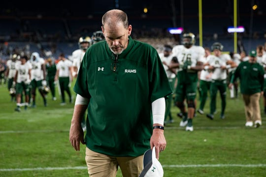 Colorado State University head coach Mike Bobo walks to the band in the stands after losing the Rocky Mountain Showdown rivalry football game to University of Colorado on Friday, August 30, 2019, at Broncos Stadium at Mile High in Denver, Colo.