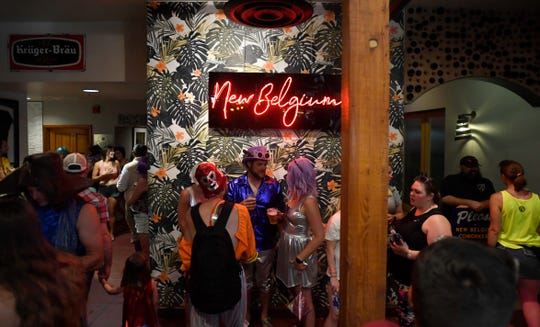 Patrons fill the taproom during Tour de Fat at the New Belgium Brewery in Fort Collins, Colo. on Saturday, Aug. 31, 2019.
