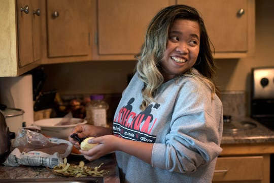 Abbeygail Mangaoang, a First Class Scholarship winner, preps potatoes for dinner in her home in Fort Collins, Colo. on Thursday, Aug. 29, 2019.
