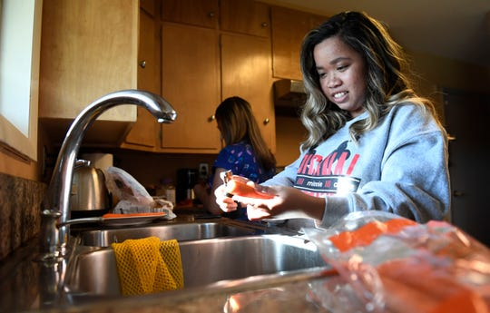 Abbeygail Mangaoang, a First Class Scholarship winner, preps carrots for dinner in her home in Fort Collins, Colo. on Thursday, Aug. 29, 2019.