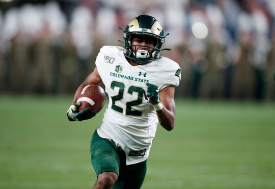 Colorado State wide receiver Dante Wright runs for a touchdown against Colorado during the second quarter of an NCAA college football game Friday, Aug. 30, 2019, in Denver. Wright said he greatly benefited from recruiting exposure during spring of his junior year.
