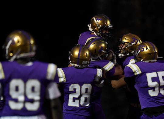 Fort Collins High School football players celebrate after Chris Aldana returned an interception for a touchdown during an Aug, 30, 2019, loss to Rocky Mountain at French Field. The Lambkins face Fossil Ridge at 7 p.m. Friday at French Field.