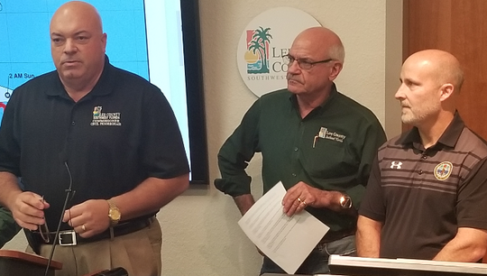 County Commissioner Cecil Pendergrass, with County Manger Roger Desjarlais and Lee School Superintendent Gregory Adkins at briefing on Hurricane Doran in the wake of changes in the storm path taking it away from Lee County.