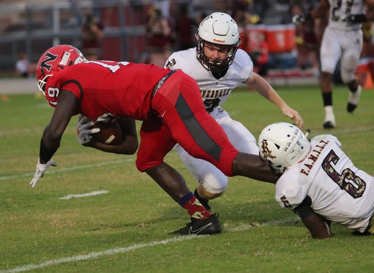 Riverdale senior Raekwon Clark (6) makes a tackle against North Fort Myers in the first half of a 9-6 loss Friday at Moody Field. Clark suffered an injury in the fourth quarter and was taken away in an ambulance. He was discharged from the hospital early Saturday morning.