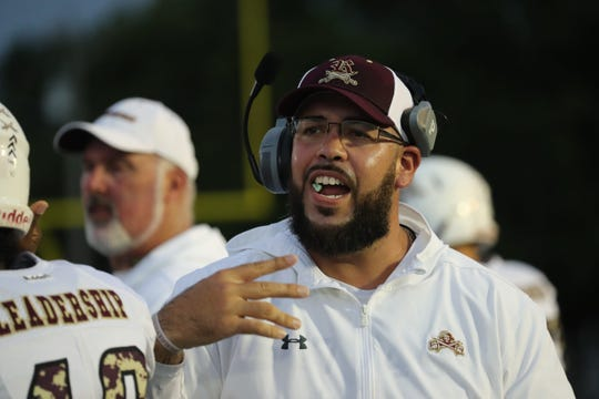 Riverdale High School football coach James Delgado, shown Aug. 30, 2019, when Riverdale took on host North Fort Myers, was named in the lawsuit filed by the mother of Zachary Martin-Polsenberg, who died of heat-related illness in 2017.
