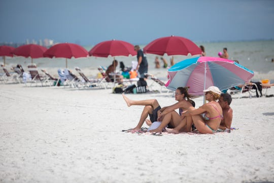 Visitors to Fort Myers Beach watch the entertainment at the Lani Kai Island Resort on Saturday, August 31, 2019.