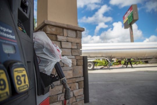 A tanker truck refills the tanks at the RaceTrac gas station at the corner of Cleveland Avenue and Edison Avenue on Saturday.