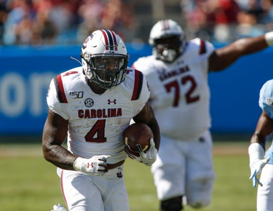 South Carolina running back Tavien Feaster rushes for a touchdown in the first half against North Carolina