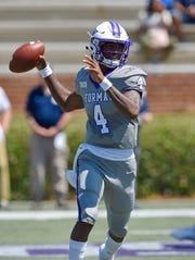 Furman quarterback Darren Granger scrambles out of the pocket and throws a pass during the first half.  Furman hosts Charleston Southern in a SOCON football game Saturday, Aug. 31, 2019.