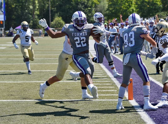 Furman's Devin Wynn scores a touchdown during the first half. Furman hosts Charleston Southern in a SOCON football game Saturday, Aug. 31, 2019.