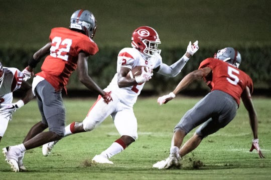 Greenville's Khalique Holland (2) runs the ball during their game at Wade Hampton Friday, August 30, 2019.