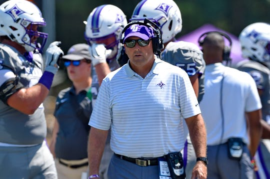 Furman head coach Clay Hendrix works the sideline during the first half. Furman hosts Charleston Southern in a SOCON football game Saturday, Aug. 31, 2019.