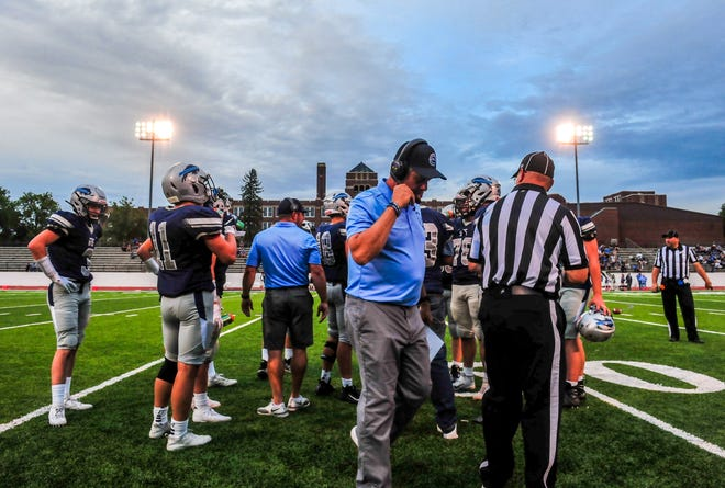 Great Falls HIgh huddles during  a timeout in Friday's football game against Missoula Sentinel.