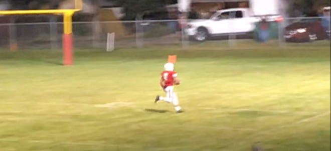 Conrad defender Tommy Hammond is all alone as he races toward the end with the winning score in the Cowboys' 34-28 victory over Deer Lodge Friday night in Conrad.
