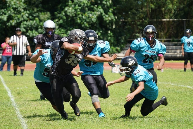 The Simon Sanchez Sharks beat the Southern High Dolphins 24-20 win in IIAAG High School Football Aug. 31 at Southern High.