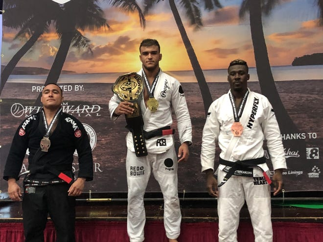 Marianas Open Black Belt Division 2 winners are Kaynan Duarte, at center, second place Javier Mirelez from Purebred BJJ Guam and in third at right, Rida Haisam. Duarte went on to win the absolute division against teammate Ronaldo Jr.