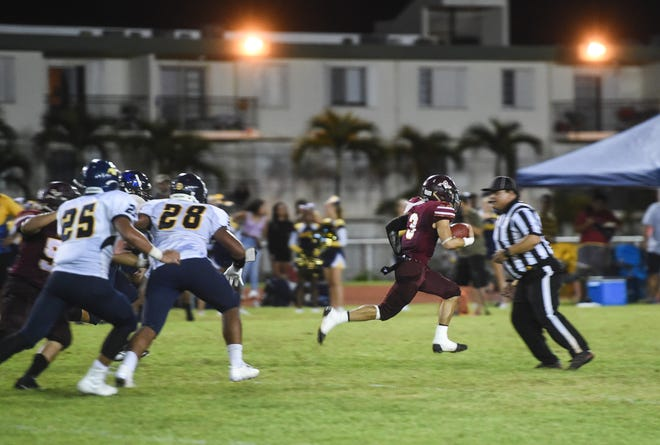 Father Duenas Friars running back Kein Artero (3) breaks away from the Guam High Panthers' defense during their IIAAG High School Football game at the George Washington High School Field in Mangilao, Aug. 30, 2019. Artero finished the game with four touchdowns in a Friars victory.