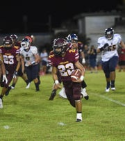 Fahter Duenas Friars running back Caiyle Gogue (22) carries the ball against the Guam High Panthers during their IIAAG High School Football game at the George Washington High School Field in Mangilao, Aug. 30, 2019.