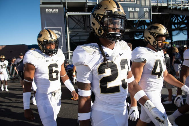 Aug 30, 2019; Reno, NV, USA; From left, Purdue Boilermaker safety Jalen Graham (6) and safety Cory Trice (23) walk on to the field with teammates against the Nevada Wolf Pack at Mackay Stadium. Mandatory Credit: David Calvert-USA TODAY Sports