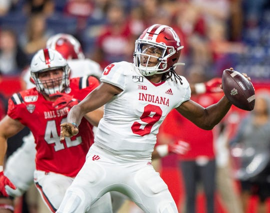 Indiana Hoosiers quarterback Michael Penix Jr. (9) drops back to pass during the second half of action in the Kickoff Classic. Indiana University faced off against Ball State at Lucas Oil Stadium in Indianapolis, Saturday, Aug. 31, 2019. Indiana won 34-24.