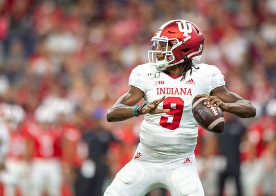 Indiana Hoosiers quarterback Michael Penix Jr. (9) drops back to pass during the first half of action in the Kickoff Classic. Indiana University faced off against Ball State at Lucas Oil Stadium in Indianapolis, Saturday, Aug. 31, 2019.