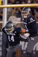 Nevada Wolf Pack wide receiver Dominic Christian celebrates a touchdown with quarterback Carson Strong (12) against the Purdue Boilermakers during the second quarter at Mackay Stadium.