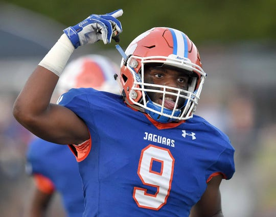 Madison Centra's Andre Mack (9) celebrates his interception against Brandon at Madison Central High School on Friday, August 30, 2019, in Madison, Miss.
