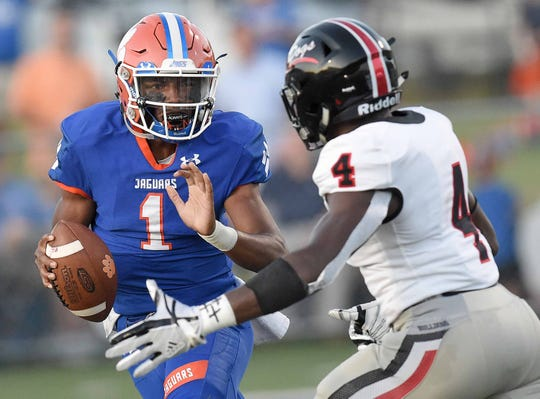 Madison Centra's Jimmy Holiday (1) looks to get by Brandon's Willie Miller (4) at Madison Central High School on Friday, August 30, 2019, in Madison, Miss.