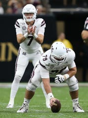 Mississippi State's Evans Wilkerson (79) prepares to snap the ball to Mississippi State's Tommy Stevens (7). Mississippi State played Louisiana to open the 2019 football season on Saturday, August 31, 2019 in the Superdome in New Orleans. Photy by Keith Warren