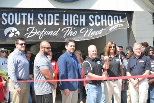 Jackson-Madison County central office administrators, board members, county commissioners and South Side staff, coaches and players held a ribbon cutting to open the renovated stadium.