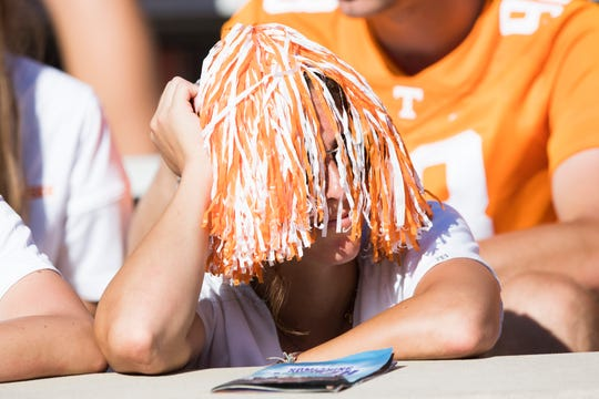 A fan watches as Tennessee falls behind during a Tennessee Vols football game against Georgia State in Neyland Stadium, Saturday, Aug. 31, 2019. The Vols lost, 38-30.