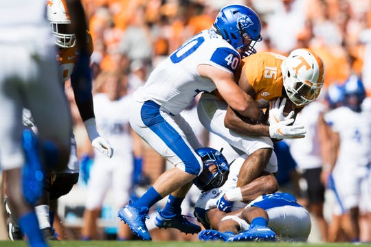 Tennessee wide receiver Jauan Jennings (15)  is taken down by Georgia State linebacker Jordan Veneziale (40) during the first half of a Tennessee Vols football game against Georgia State in Neyland Stadium, Saturday, Aug. 31, 2019.