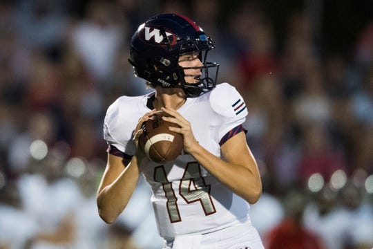 West's Baker Dance (14) gets set to throw against Farragut on Aug. 30. The Rebels notched their second win of the season that Friday and are now 7-0 heading into a showdown Oct. 18 at undefeated Powell.