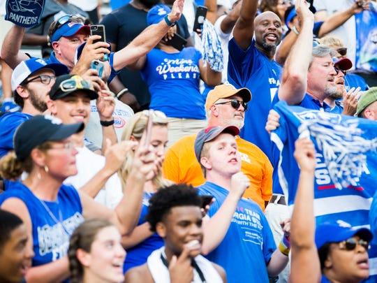 A Tennessee fan watches as Georgia State players and fans celebrate after the Vols lost to Georgia State 38-30 in Neyland Stadium in Knoxville on Saturday, August 31, 2019.