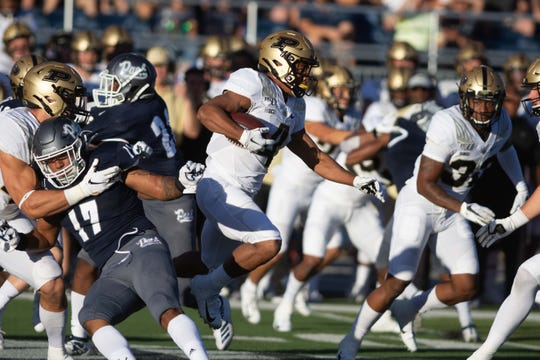 Aug 30, 2019; Reno, NV, USA; Purdue Boilermakers wide receiver Rondale Moore (4) runs up field against the Nevada Wolf Pack during the first quarter at Mackay Stadium. Mandatory Credit: David Calvert-USA TODAY Sports